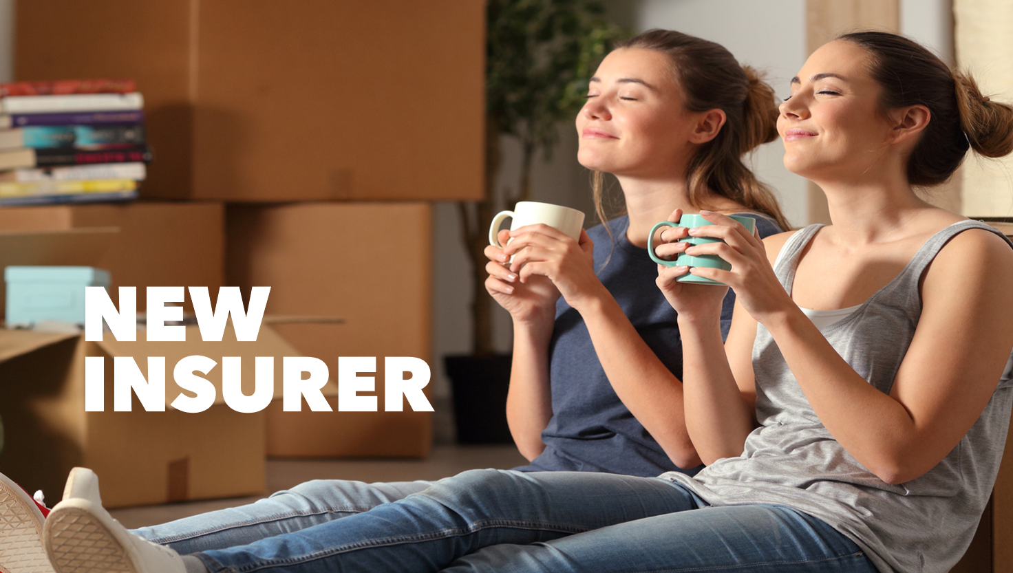 two women sat on the floor with hot drinks taking a break on moving-in day